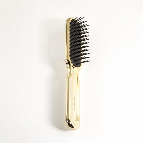 Spazzola da testa rettangolare grande con riccio stampato, resistente al phon, di colore oro.