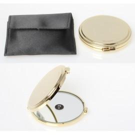Specchio da borsetta con specchio ingrandimento x3. ø8cm.